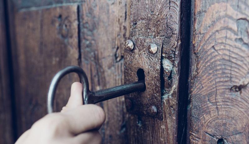 Key opening a door.