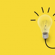 Yellow background with image of a light bulb turned on.
